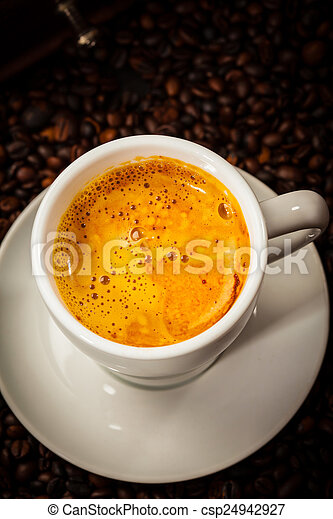 Espresso cup in coffee beans - csp24942927