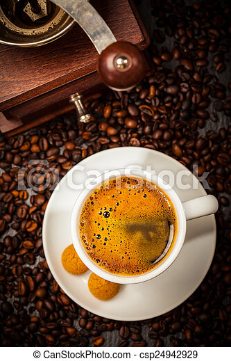 Espresso cup in coffee beans - csp24942929