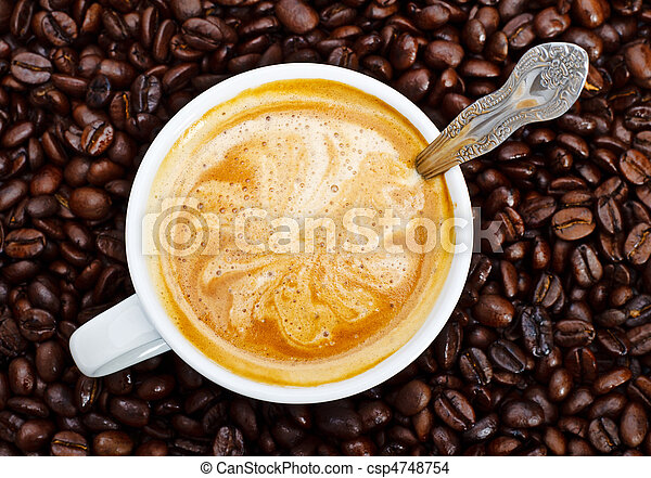 espresso cup in coffee beans - csp4748754