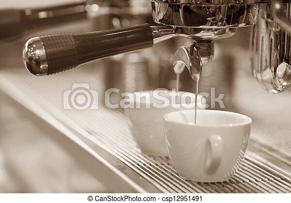 Espresso machine brewing a coffee espresso  - csp12951491