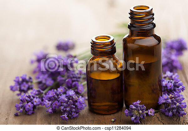 essential oil and lavender flowers  - csp11284094