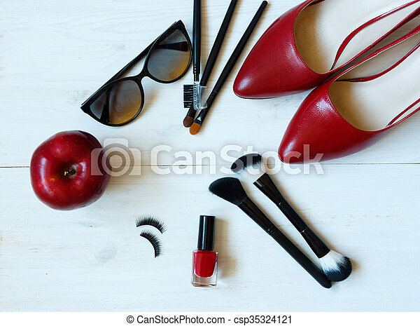 Essentials fashion woman objects on  wooden background - csp35324121