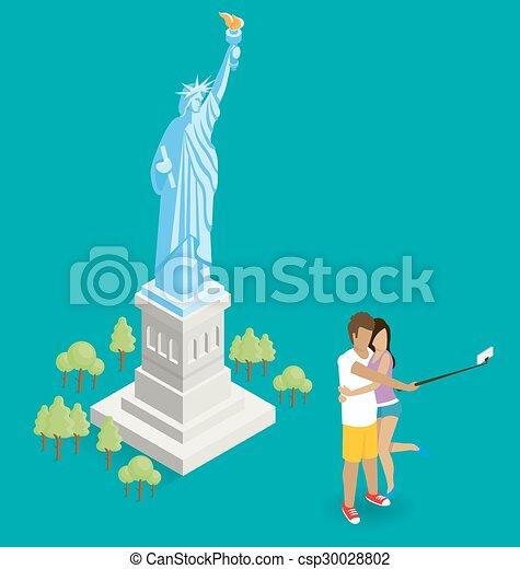 Una pareja haciendo selfie cerca de la estatua de la libertad en EE.UU - csp30028802