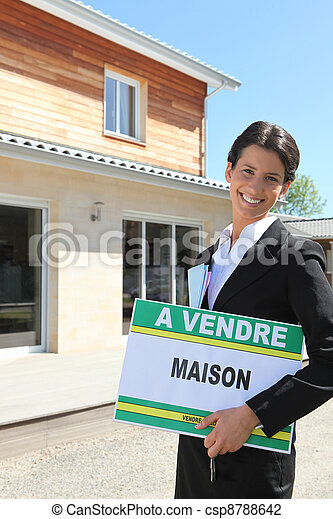 Estate agent standing in front of a house - csp8788642