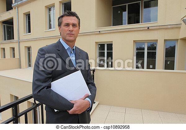 Estate-agent stood outside property - csp10892958