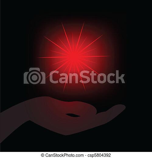 Estrella roja en la palma - csp5804392