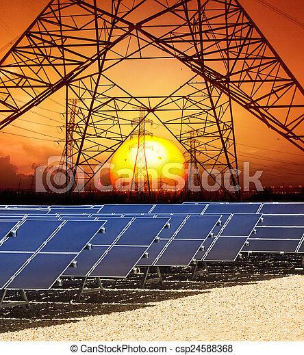 Sol puesto con estructura de alto voltaje torre eléctrica y - csp24588368