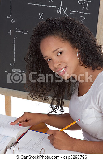 ethnic black college student woman studying math exam - csp5293796
