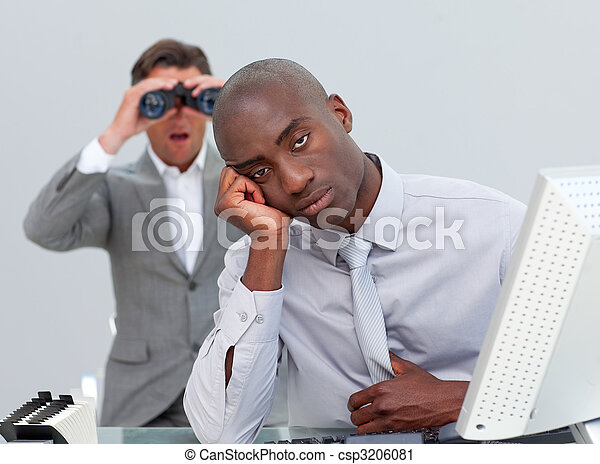 Ethnic businessman getting bored and his manager looking through binoculars in the office - csp3206081