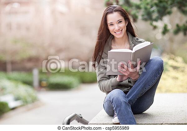 Ethnic college student studying - csp5955989