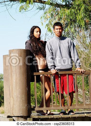 Ethnic Couple Standig At Rail On Dock - csp23608313