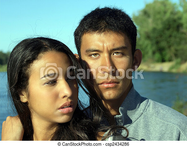 Ethnic couple young man woman at river outdoors - csp2434286
