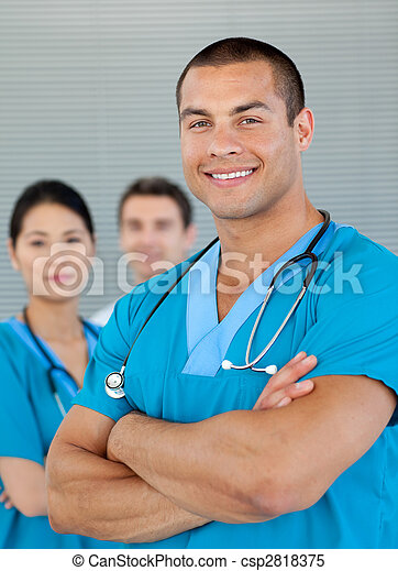 Ethnic doctor with his colleagues in the background - csp2818375