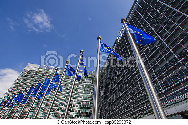 EU flags in front of European Commission in Brussels - csp33293372