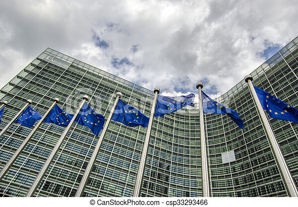 EU flags in front of European Commission in Brussels - csp33293466