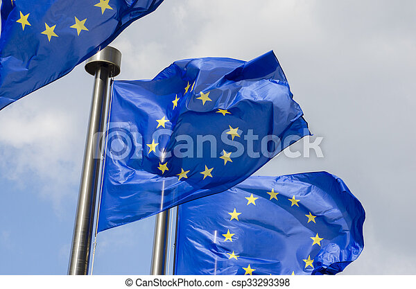EU flags in front of European Commission in Brussels - csp33293398