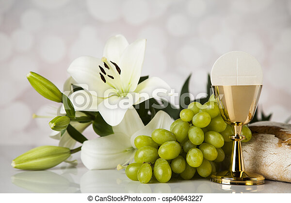 Eucharist symbol of bread and wine, chalice and host, First communion background - csp40643227