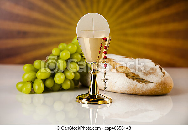 Eucharist symbol of bread and wine, chalice and host, First communion background - csp40656148