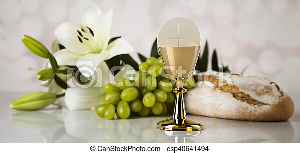 Eucharist symbol of bread and wine, chalice and host, First communion background - csp40641494