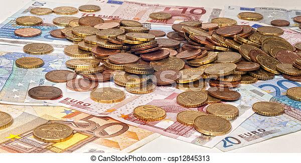 Euro banknotes and coins - csp12845313