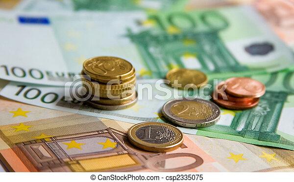 Euro banknotes and coins - csp2335075