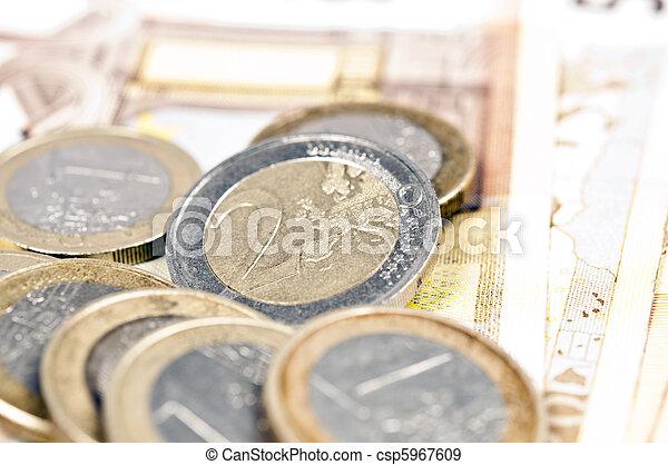 Euro banknotes and coins - csp5967609