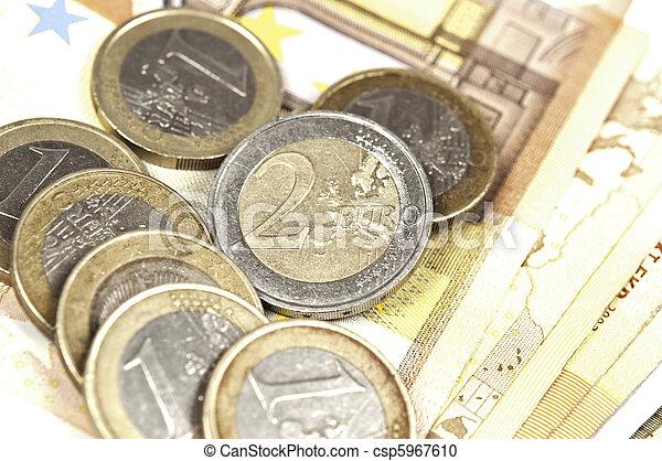 Euro banknotes and coins - csp5967610