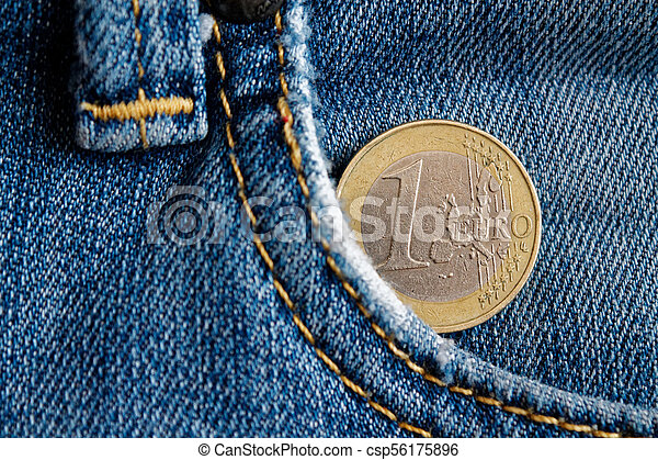 Euro coin with a denomination of 1 euro in the pocket of blue denim jeans - csp56175896