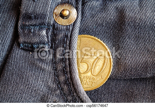 Euro coin with a denomination of fifty euro cents in the pocket of obsolete blue denim jeans - csp56174647