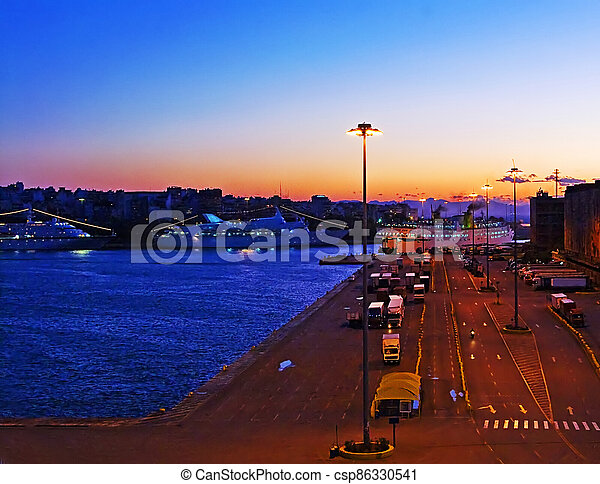 Evening in the passenger port of Piraeus, Athens (sunset) - csp86330541