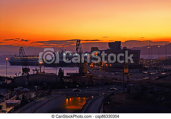 Evening in the passenger port of Piraeus, Athens (sunset) - csp86330304