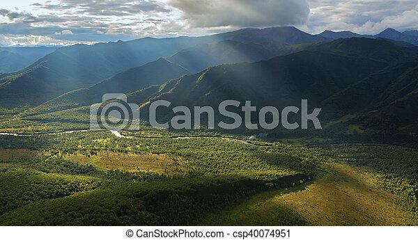 Evening rays on Kronotsky Nature Reserve in Kamchatka Peninsula. - csp40074951
