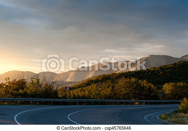Evening road and range of mountains - csp45765646