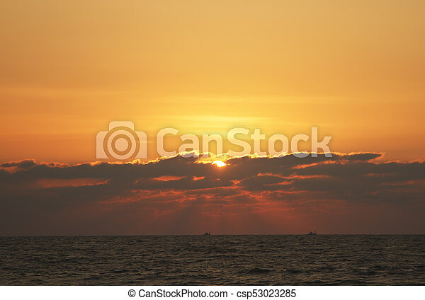 Evening scene with sunset on the sea - csp53023285