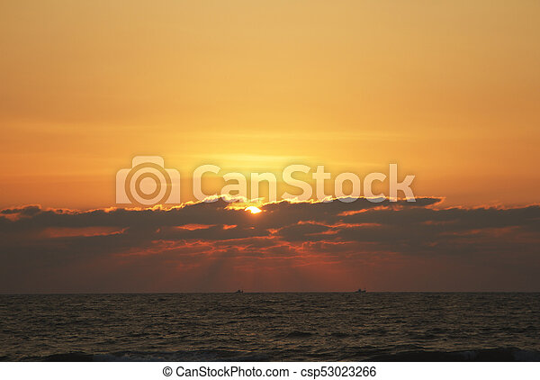 Evening scene with sunset on the sea - csp53023266