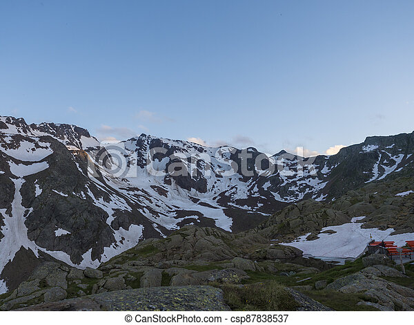 Evening sunset summer view of Bremer Hutte, terrace with snow-capped moutain peaks, Stubai Alps, Tyrol, Austria - csp87838537