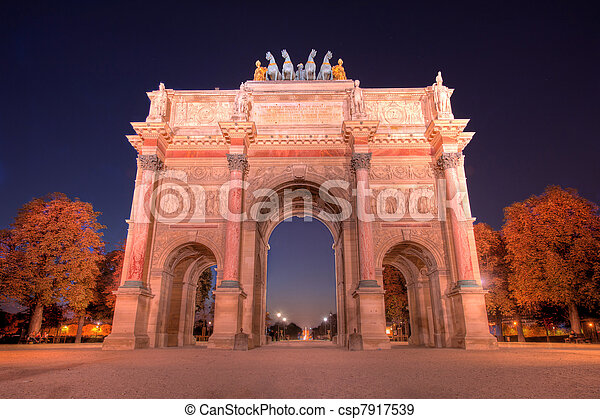 Evening traffic on Champs-Elysees in front of Arc de Triomphe (Paris, France) - csp7917539