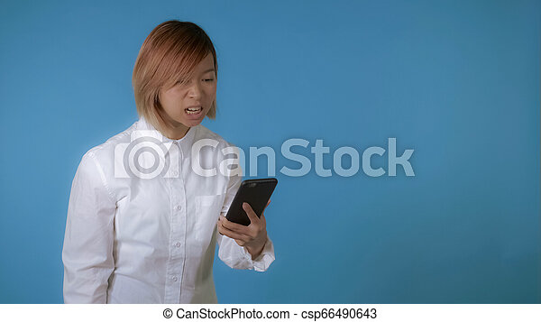 evil girl using smartphone - csp66490643