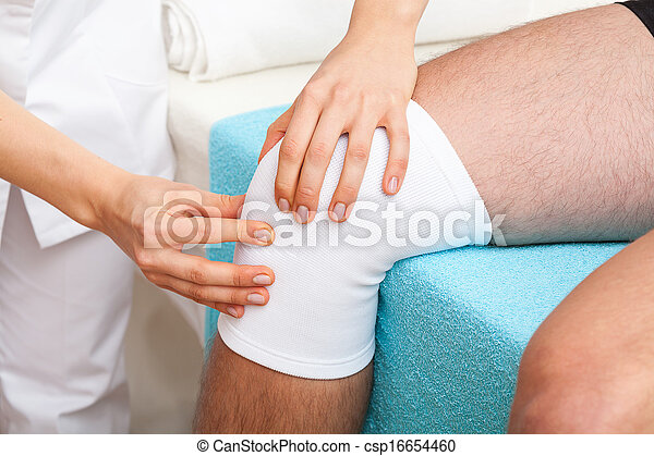 Examination of knee - csp16654460