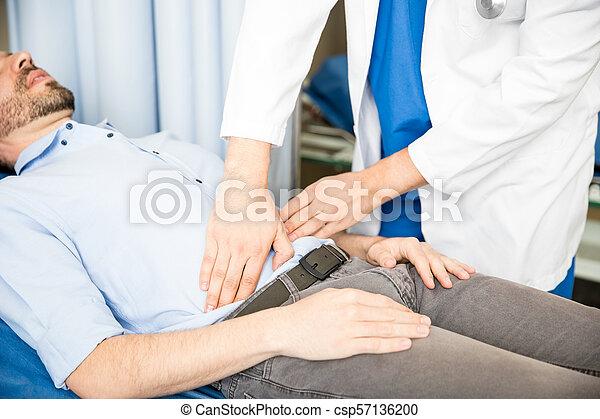 examiner, patient, abdomen, docteur - csp57136200