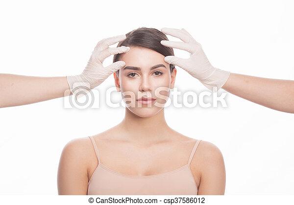 Examining face concept - csp37586012