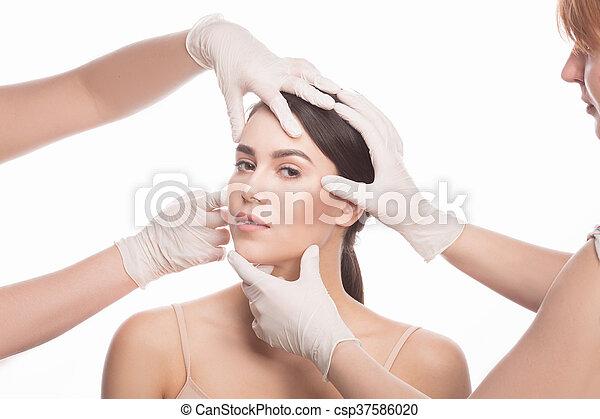 Examining face concept - csp37586020
