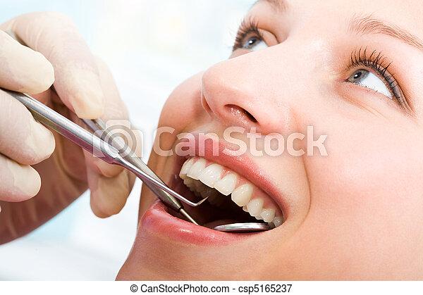 Examining mouth - csp5165237