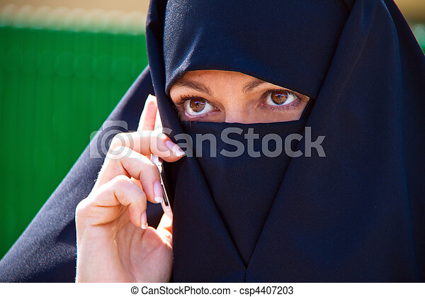 Example picture Islam. Muslim veiled woman with a burqa. - csp4407203
