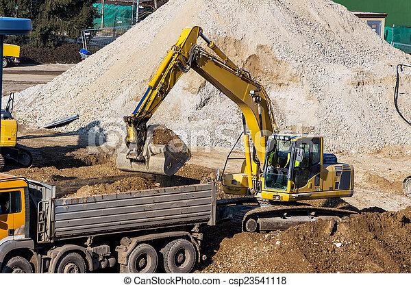 excavator at construction site during excavation - csp23541118