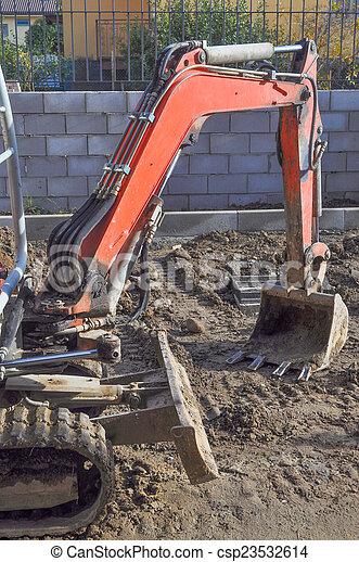 Excavator digging a hole - csp23532614