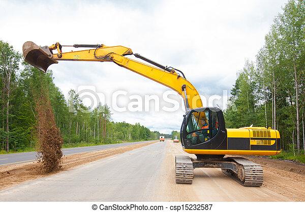 Excavator during road construction - csp15232587