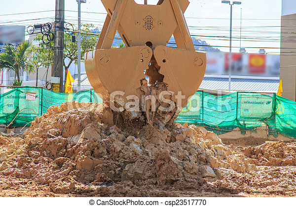 excavator in action digging soil - csp23517770