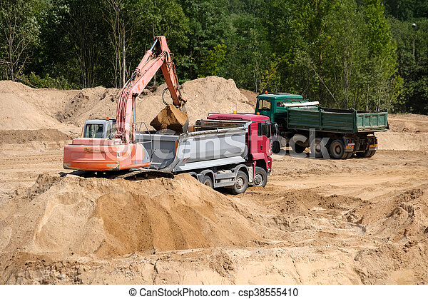 Excavator loads the ground in the truck - csp38555410