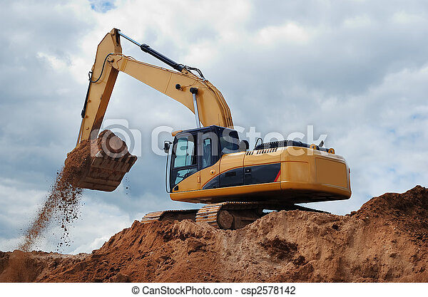 Excavator with earth in the bucket - csp2578142